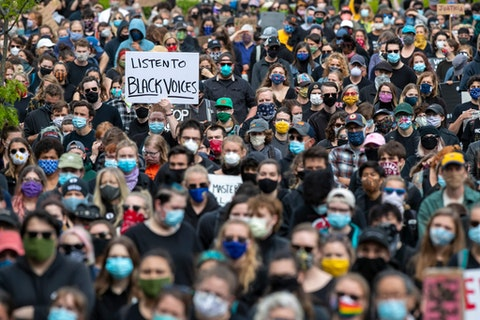 FILE - In this June 3, 2020, file photo, demonstrators gather at a rally to protest and demand an end to institutional racism and police brutality, in Portland, Maine. As a new generation steps up, activists and historians believe there's important work for white people: Listening to black voices and following rather than leading, for one, and the deep introspection it takes to confront unconscious bias and the perks of privilege that come just from being white. (AP Photo/Robert F. Bukaty, File)