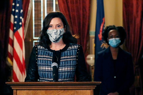 In a photo provided by the Michigan Office of the Governor, Gov. Gretchen Whitmer addresses the state during a speech in Lansing, Mich., Thursday, Nov. 5, 2020. The governor said she sent a letter to Republican lawmakers this week asking them to pass a bill to require residents wear masks in indoor places and crowded outdoor areas. (Michigan Office of the Governor via AP)