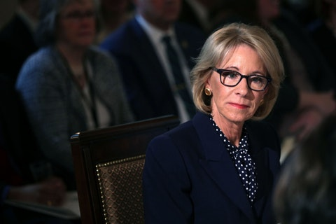 U.S. Secretary of Education Betsy DeVos listens during an Interagency Working Group on Youth Programs meeting at the State Dining Room of the White House March 18, 2019 in Washington, DC. First lady Melania Trump convened a meeting of the group to discuss youth programs that align with her Be Best initiative.  (Photo by Alex Wong/Getty Images)