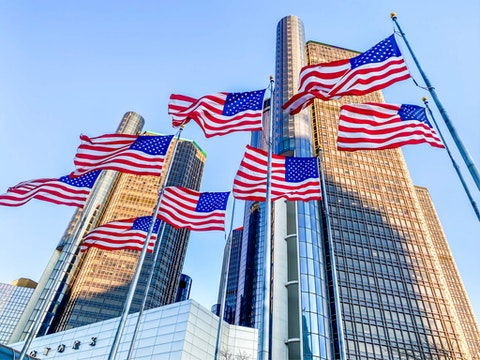 Flags fly at the GM Renaissance Center in Detroit.