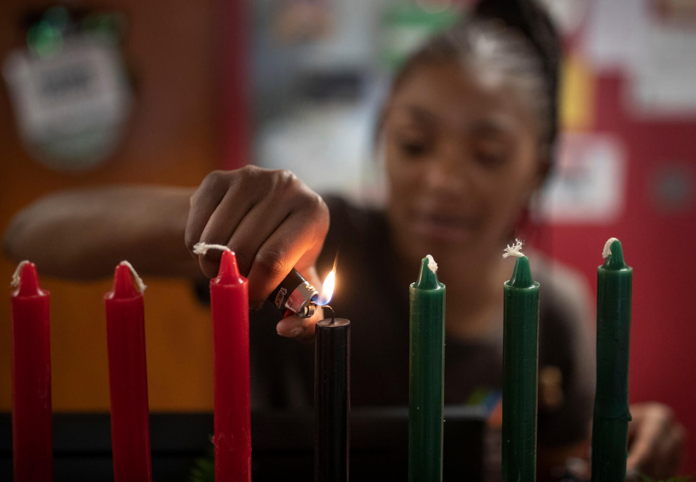 Kamora Shambley lights the first of seven candles during a celebration of the first day of Kwanzaa at the Martin Luther King Recreation Center Wednesday, December 26, 2018, in St. Paul, MN. (Photo By Jerry Holt/Star Tribune via Getty Images)