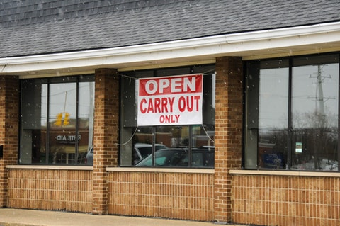 "PLYMOUTH, MI  - APRIL 22: A sign displays ""Open Carry Out Only"" at a restaurant as the coronavirus pandemic continues on April 22, 2020 in Plymouth, Michigan. Michigan Governor Gretchen Whitmer issued a stay at home executive order for non-essential workers on March 24th and has banned all gatherings, public or private for the entire State due to the coronavirus (COVID-19) global pandemic.  (Photo by Aaron J. Thornton/Getty Images)"