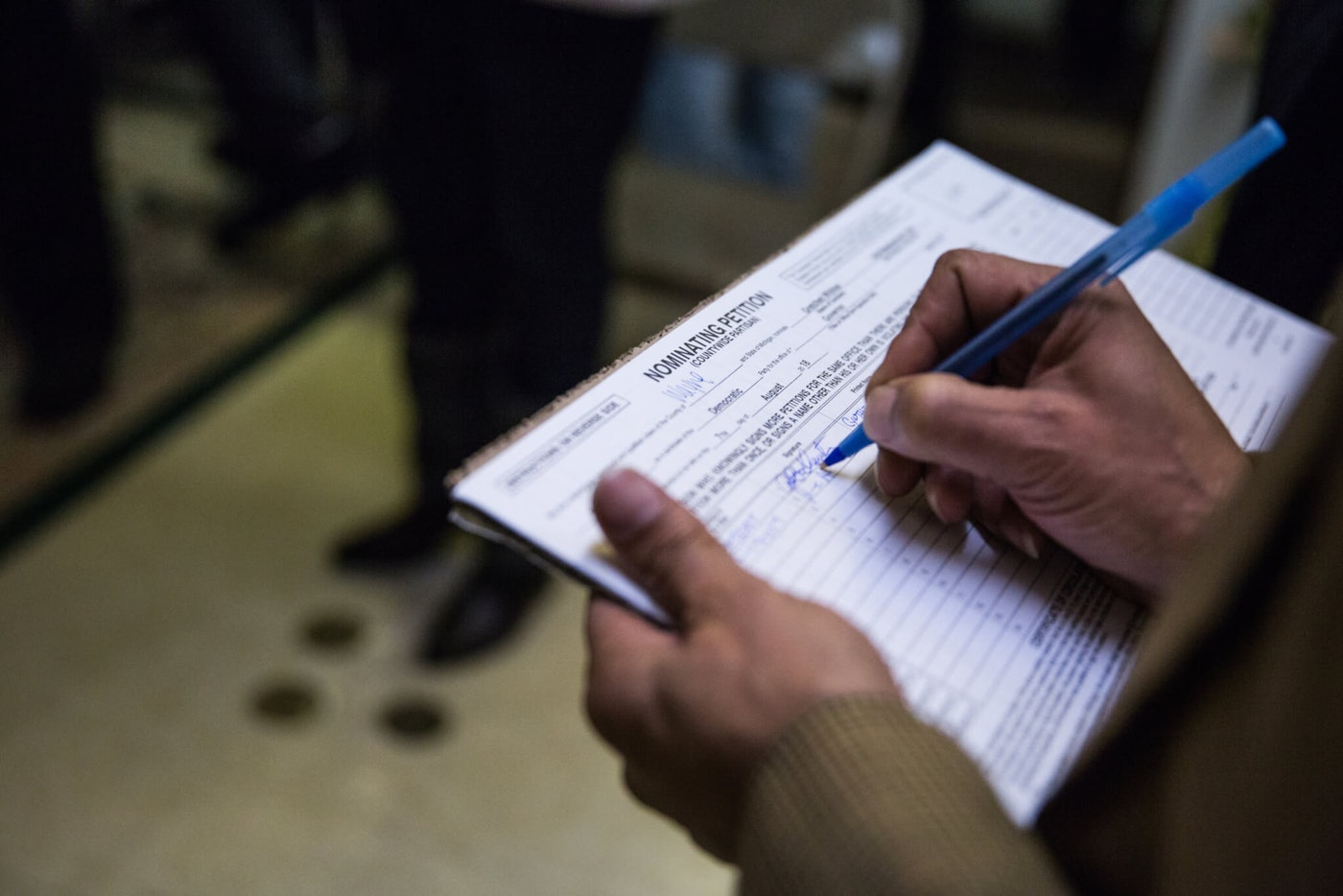 DETROIT, MI  - DECEMBER 19: A community member signs a nominating petition to help gain Gretchen Whitmer ballot access for Michigan Governor.  (Photo by Ali Lapetina for The Washington Post via Getty Images)
