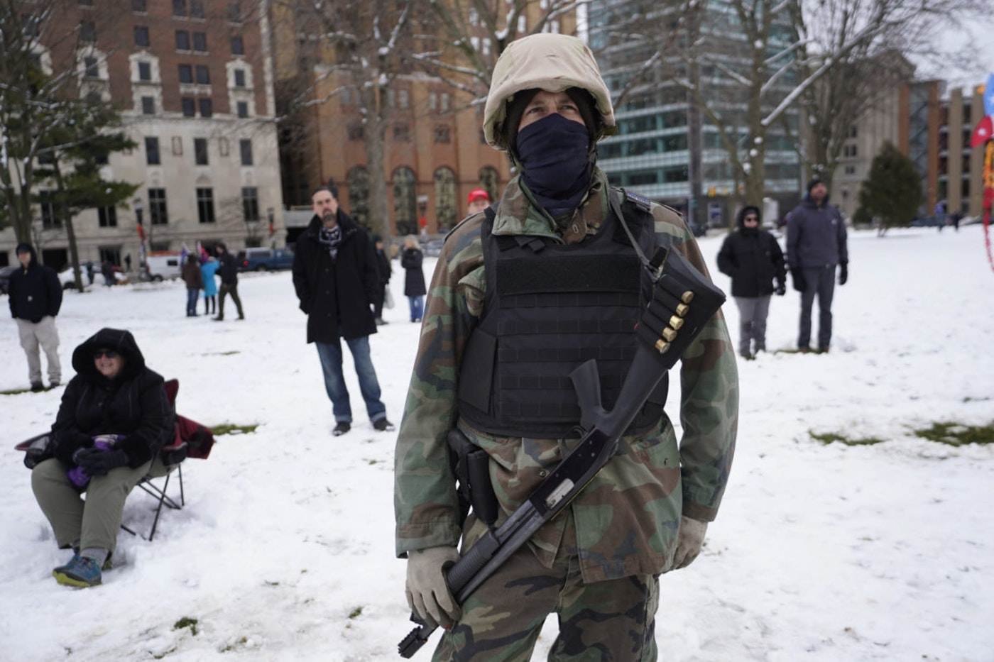 A man carries a shotgun at a rally in support of President Donald Trump at the state capitol in Lansing, Mich., Wednesday, Jan. 6, 2021. (AP Photo/Paul Sancya)
