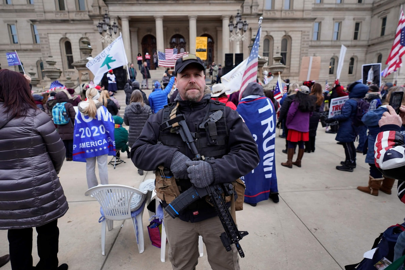 A man carries a rifle during a rally in support of President Donald Trump at the state capitol in Lansing, Mich., Wednesday, Jan. 6, 2021. (AP Photo/Paul Sancya)