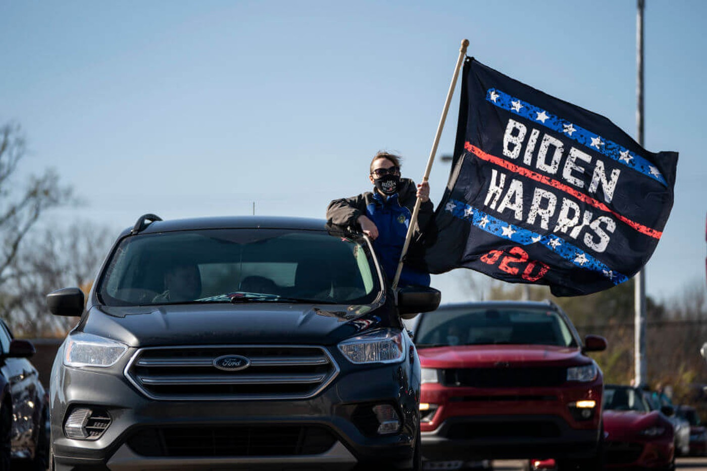 FLINT, MI - OCTOBER 31: Supporters listen in their cars as former President Barack Obama speaks during a drive-in campaign rally for Democratic presidential nominee Joe Biden at Northwestern High School on October 31, 2020 in Flint, Michigan. Biden is campaigning with former President Obama on Saturday in Michigan, a battleground state that President Donald Trump narrowly won in 2016.