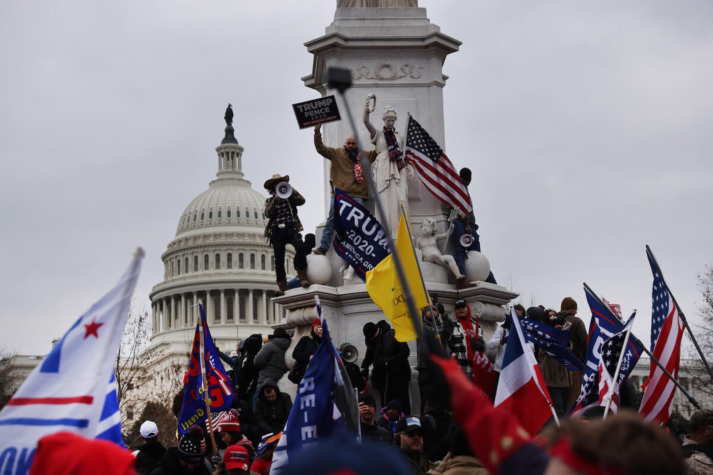 Trump supporters gathered in the nation's capital to protest the ratification of President-elect Joe Biden's Electoral College victory over President Donald Trump in the 2020 election. The demonstration turned violent and deadly. (Photo by Spencer Platt/Getty Images)