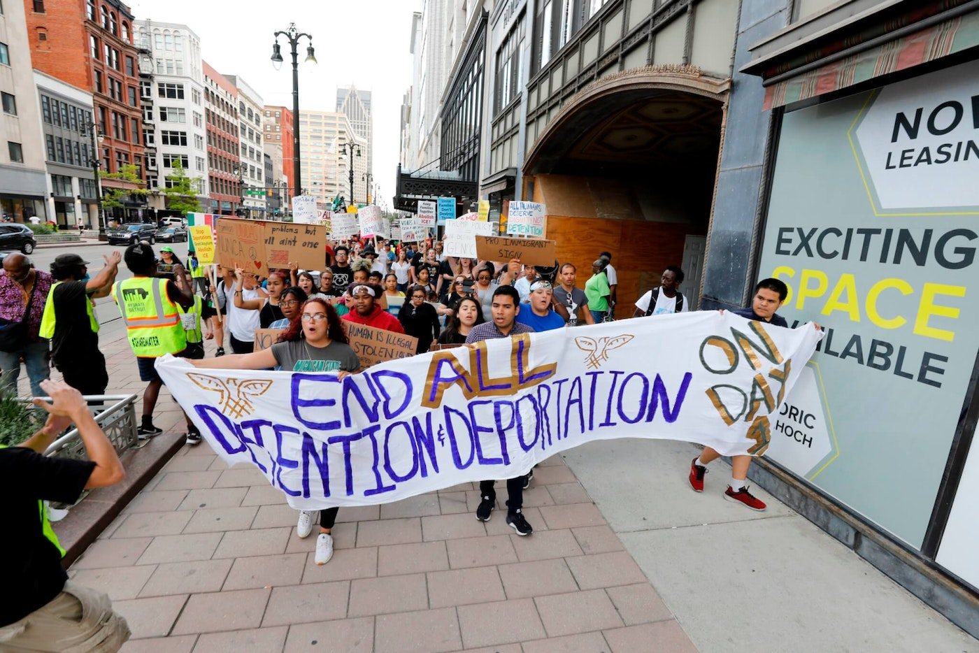 Pro-immigration protesters march down Woodward Ave to Grand Circus Park in July 2019 in Detroit, Michigan, before a Democratic primary debate taking place at the nearby Fox Theatre. (Photo by JEFF KOWALSKY /AFP via Getty Images)
