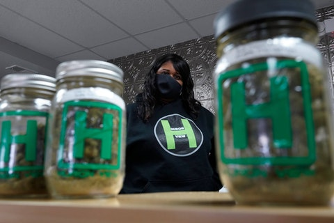 Teesha Montague works at Huron View Provisioning in Ann Arbor, Mich., Thursday, Jan. 28, 2021.  The first year of state-licensed recreational marijuana sales in Michigan saw $511 million of sales in recreational and $474 million in medical sales, generating over $100 million in tax revenue, but the state also found that the industry drastically failed to attract minority business owners.  (AP Photo/Paul Sancya)
