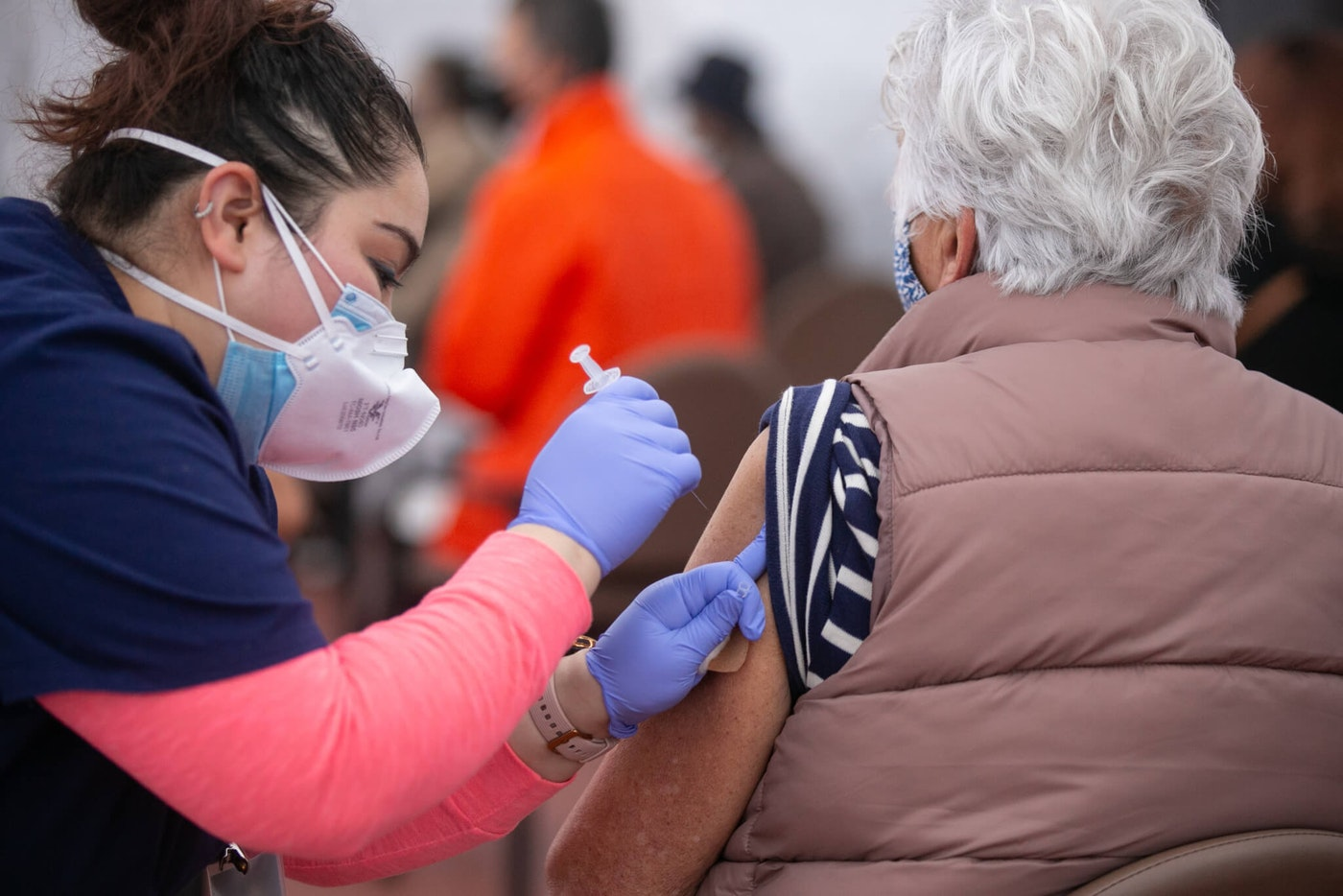 A nurse administers the COVID-19 vaccine at Kedren Health on Thursday, Feb. 11, 2021 in Los Angeles, CA. (Jason Armond / Los Angeles Times via Getty Images)