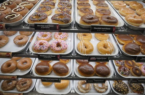 Donuts are on display inside the new Krispy Kreme flagship store amid the coronavirus pandemic in Times Square, New York, September 15, 2020. - The 4,500 square-foot donut shop includes a glaze waterfall, a 24-hour street pick-up window, and a system that can make more than 4,500 donuts an hour. (Photo by TIMOTHY A. CLARY / AFP) (Photo by TIMOTHY A. CLARY/AFP via Getty Images)