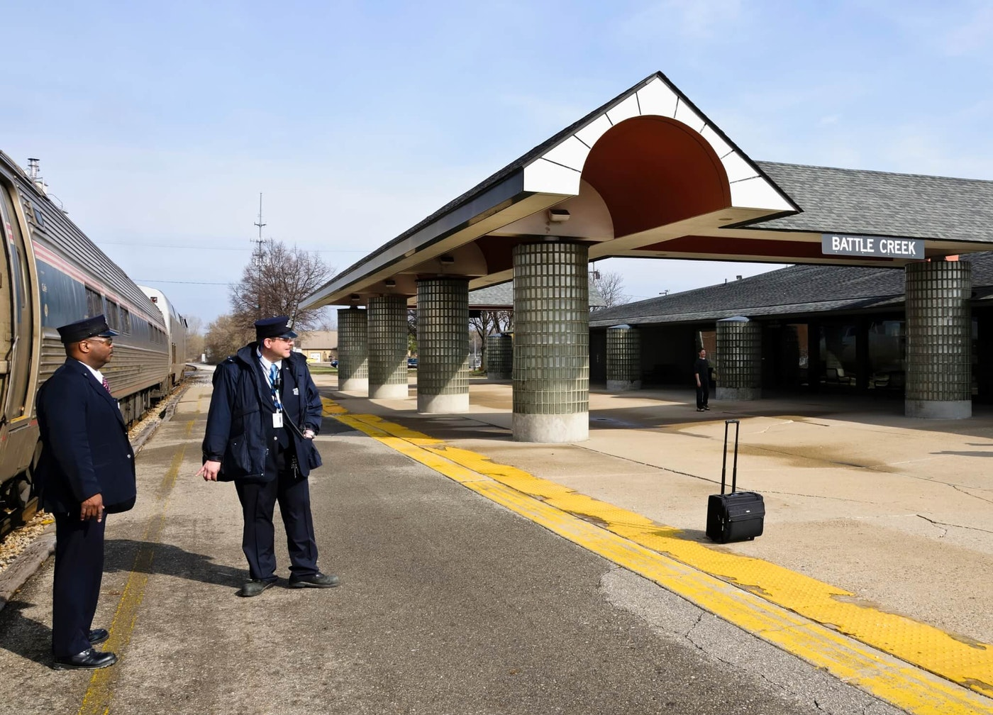 Train conductors standing at the train station in Battle Creek, Michiigan.