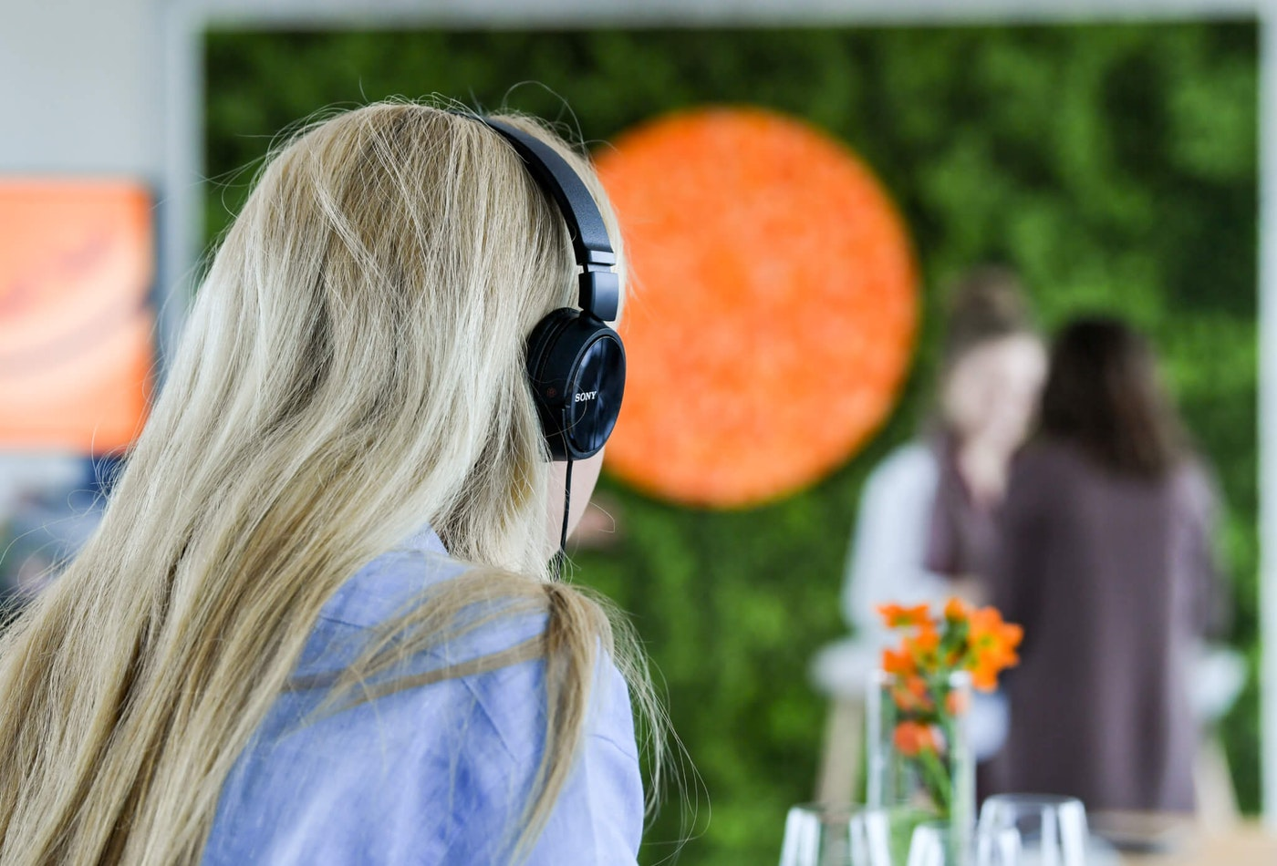 13 March 2019, Berlin: A woman listens to the Headspace meditation app, which has 40 million users worldwide, with headphones at a press event to present the new German-language offering. The app is designed to help you cope with stress. Photo: Jens Kalaene/dpa-Zentralbild/ZB (Photo by Jens Kalaene/picture alliance via Getty Images)