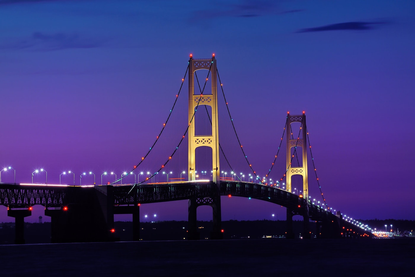 The Mackinac Bridge, also known as the Mighty Mac, spans the Straits of Mackinac, connecting Michigan's Lower and Upper Peninsulas.