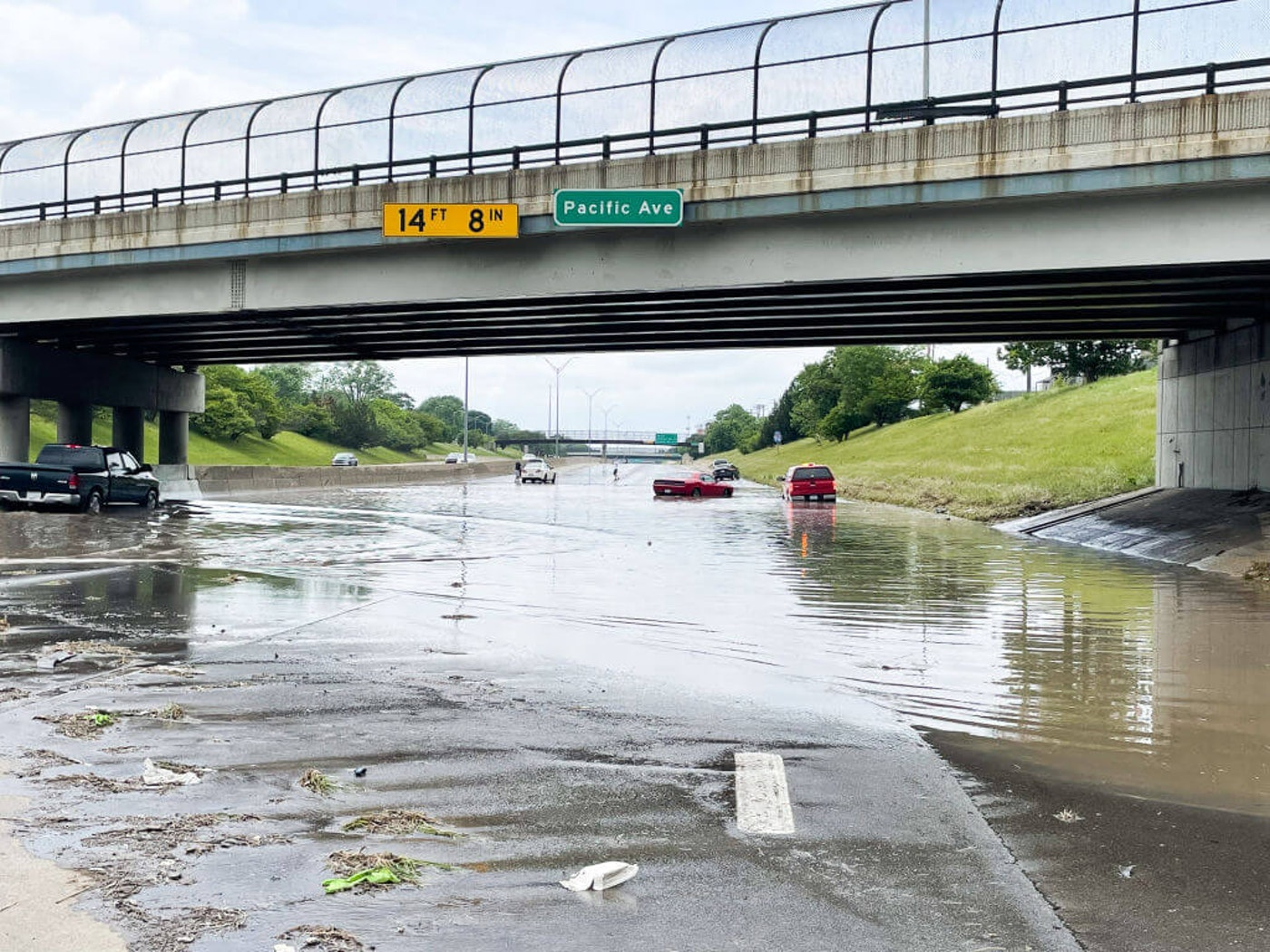 DETROIT, MI - JUNE 27: Many cars were abandoned at this I-96 overpass of Pacific Ave. causing the freeway to become impassible where the water was over 2 feet deep due to the torrential rains of the previous day during the day on I-96 freeway in Northwest Detroit on Saturday June 26, 2021 in Detroit, MI.