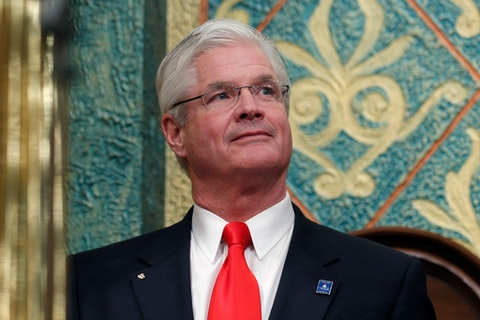 """In this Feb. 12, 2019 file photo, state Senate Majority Leader Mike Shirkey, R-Clarklake, watches during the State of the State address at the state Capitol in Lansing, Mich. Michigan lawmakers plan to convene for the first time in weeks to lengthen Gov. Gretchen Whitmer's emergency declaration amid the coronavirus pandemic but are at odds over the extension and whether the session is even necessary. The Republican-led Legislature is scheduled to meet Tuesday, April 7, 2020, three weeks after last voting. Shirkey's spokeswoman said """"He thinks we can come to some middle ground in terms of the extension, and that doesn't preclude it from being extended again if were necessary at some point."""""""