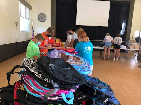 Local members of the Youth Advisory Council help with a backpack drive during the pandemic