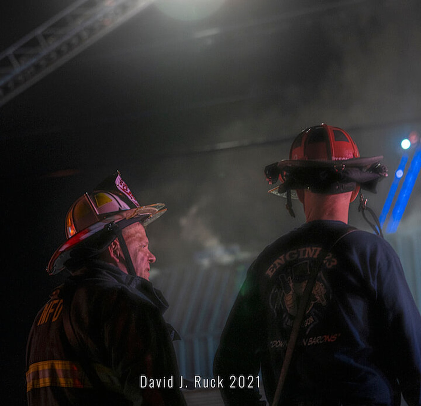 Muskegon Fire Dept. Deputy Director Jay Paulson and another firefighter see the smoke rise after being called to a fire at a Dollar General in Muskegon.