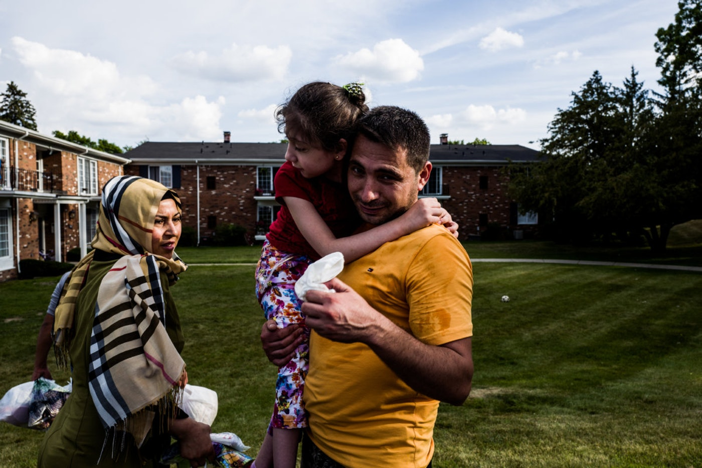 The Haji Khalif family arrives at their new home on July 24, 2015 in Bloomfield, Michigan. The Kurdish family of five moved here from their first placement home in Dearborn due to their daughters disability. They originally fled their own home in Aleppo and lived in Jordan before coming to the United States. Since the war started the United States has resettled under 1,500 refugees, despite over 12,000 applications. That fall, U.S. President Barack Obama announced that least 10,000 displaced Syrians will be allowed into the United states over the next year. This announcement was followed up by U.S. Secretary of State John Kerry announcing the United States would accept 85,000 refugees from around the world next year and that total would rise to 100,000 in 2017.
