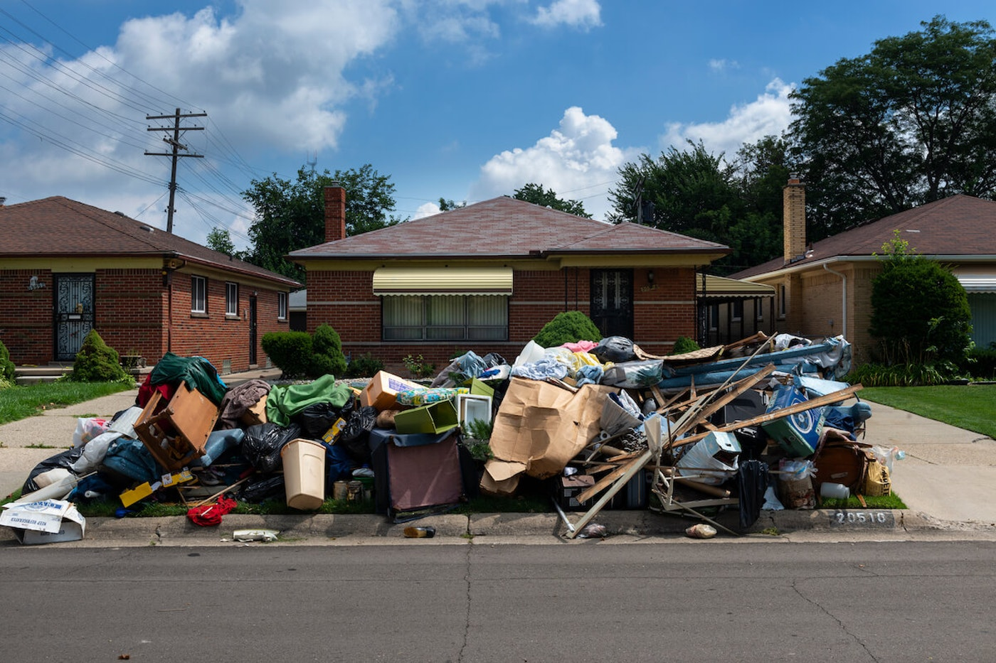 An evicted house at a suburban street with left belongings on the lawns near 8 mile road in the city of Detroit.